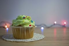 Delicious homemade cupcakes or muffins with cream stock photos