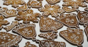 Delicious homemade decorated gingerbread cookie in shape of bell ans snowflake. Closeup of delicious homemade decorated gingerbread in shape of bell, stars stock photo