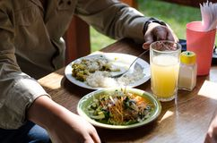 Delicious homemade food, cau cau with rice and salad stock photography
