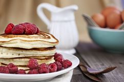 Pancakes with Fresh Rasperries. Delicious homemade golden pancakes with fresh raspberries. Extreme shallow depth of field Stock Images