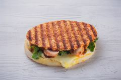 A delicious homemade grilled salmon burger with salad and sauce royalty free stock photos