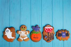 Delicious homemade Halloween ginger cookies with ghosts, pumpkin royalty free stock images