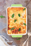 Delicious homemade lasagna in a baking dish Stock Photo