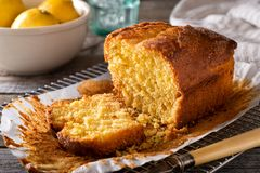 Rustic Lemon Loaf. A delicious homemade lemon loaf on a rustic table top royalty free stock images