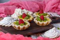Delicious homemade lemon tart. Pie on rustic white table. Tart with raspberries and meringue Royalty Free Stock Photos