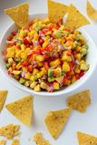 A delicious homemade Mexican salsa. A delicious homemade Mexican salsa with mango, corn, avocado, red onion, lime, cilantro and pepper royalty free stock images