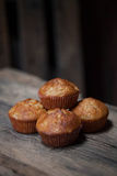Delicious homemade muffins over wooden board. Selective focus Royalty Free Stock Photos
