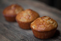 Delicious homemade muffins over wooden board. Selective focus Royalty Free Stock Images