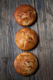 Delicious homemade muffins over wooden board. Selective focus Royalty Free Stock Photography