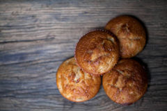 Delicious homemade muffins over wooden board. Selective focus Royalty Free Stock Image