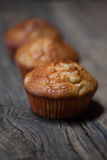 Delicious homemade muffins over wooden board. Selective focus Stock Photo