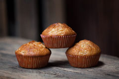 Delicious homemade muffins over wooden board Royalty Free Stock Image