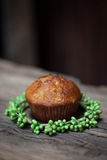 Delicious homemade muffins over wooden board Royalty Free Stock Photography