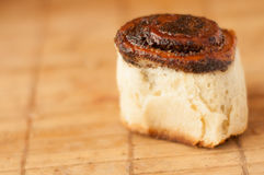 Delicious Homemade muffins roll with poppy seeds in warm color background. Selective focus royalty free stock images