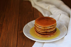 Delicious homemade pancakes. And honey on the plate on the  brown wooden table Stock Photos