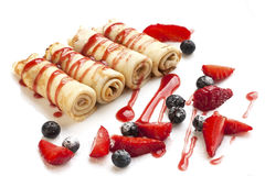 Delicious homemade pancakes with juicy berries and sauce Stock Images