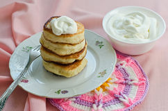 Delicious homemade pancakes with sour cream. Stock Photography