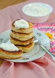Delicious homemade pancakes with sour cream. Royalty Free Stock Photography