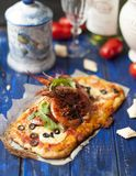 Delicious homemade pastries, Italian pizza with shrimps and spices, top view. stock photos