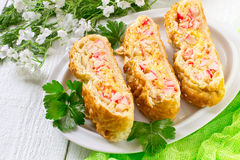 Delicious homemade pie with cheese and surimi Stock Photo