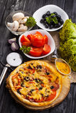 Delicious Homemade pizza served on wooden table Stock Photo