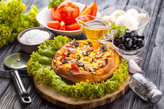 Delicious Homemade pizza served on wooden table Royalty Free Stock Images