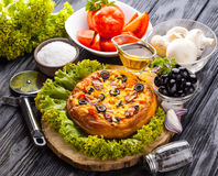 Delicious Homemade pizza served on wooden table Royalty Free Stock Photo