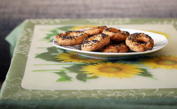Delicious homemade pretzels with poppy on the table. Photo of delicious homemade pretzels with poppy on the table stock photo