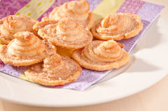 Delicious homemade puff pastry cookies. On a white plate Royalty Free Stock Photography
