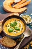 Delicious homemade pumpkin soup with basil leaves. Stock Image
