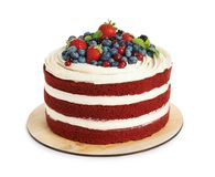 Delicious homemade red velvet cake with fresh berries. On white background stock photos