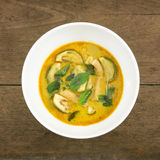 The delicious homemade Thai green curry with pork (Gang Keaw Wan) in white bowl Stock Photo