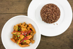 The delicious homemade Thai paneang curry food and cooked brown rice Royalty Free Stock Photography