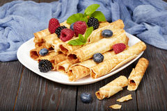 Waffle rolls with berries Royalty Free Stock Photo