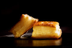 Delicious honey pastries on black background.  Stock Image