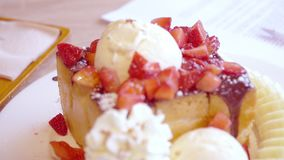Delicious honey toast with ice cream and fruit on top in sweet and dessert shop stock video footage