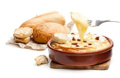Delicious  hot baked camembert  with sultanas isolated on white. Delicious  hot baked camembert with sultanas isolated on white Stock Images