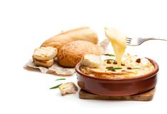 Delicious  hot baked camembert  with sultanas isolated on white. Delicious  hot baked camembert with sultanas isolated on white Stock Photos