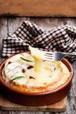 Delicious  hot baked camembert  with sultanas on wooden table. Delicious  hot baked camembert with sultanas on wooden table Royalty Free Stock Image