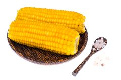 Delicious hot cobs of boiled sweet corn on wooden background Stock Photography