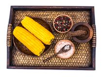 Delicious hot cobs of boiled sweet corn on wooden background Royalty Free Stock Photography