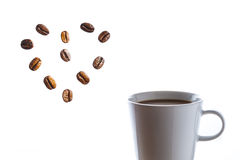 Delicious hot coffee with heart of beans Royalty Free Stock Images