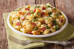 Delicious hot colored tortellini with parmesan and sliced sausag Royalty Free Stock Photo