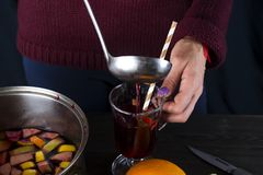 Woman pouring hot mulled wine Royalty Free Stock Images