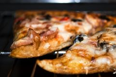 Delicious hot pizza in the oven stock image