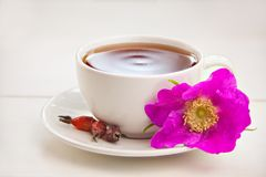 Delicious hot tea from red rosehip. On table Stock Photography