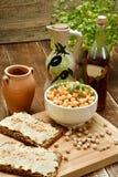 Delicious hummus on bread. Stock Photos