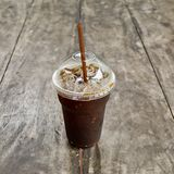 Delicious ice coffee americano on old wood table. Stock Photo