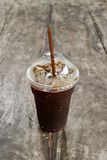Delicious ice coffee americano on old wood table. Royalty Free Stock Photo