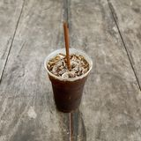Delicious ice coffee americano on old wood table. Royalty Free Stock Image